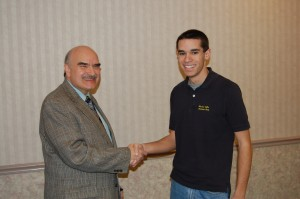"Jim Mehrling congratulates Coury for winning $200 as ""Standout Scholar"""