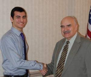 Stamatis, left, is congratulated by program host Jim Mehrling