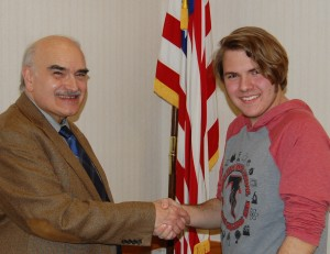 Durdak, right, is congratulated by program producer Jim Mehrling.